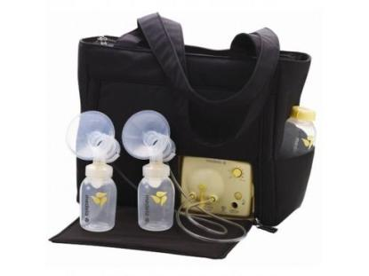 $100 // Medela Pump In Style Double Breast Pump. AC Adapter and battery power. Comes with items shown plus a bunch of extras including storage bottles and a hands free pumping bra.